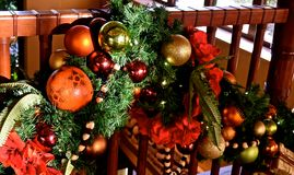 Festive Bannister. Christmas themed ornaments adorned on a bannister stock image