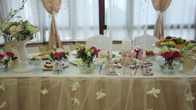 Festive banquet hall. Festive, decorated banquet hall for weddings. Beautiful elegant wedding reception table arrangement. Tables setting at a luxury wedding stock video footage