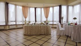 Festive banquet hall. Festive, decorated banquet hall for weddings. Beautiful elegant wedding reception table arrangement. Tables setting at a luxury wedding stock video