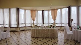 Festive banquet hall. Festive, decorated banquet hall for weddings. Beautiful elegant wedding reception table arrangement. Tables setting at a luxury wedding stock footage