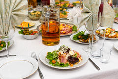 A festive banquet table with delicious fine dishes close-up. Royalty Free Stock Photos