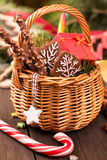 Festive basket of gifts and Christmas decorations closeup Royalty Free Stock Photo