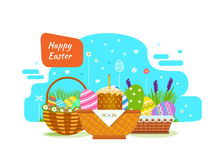 Festive, beautiful, Easter baskets with painted eggs, flowers, bakery products. Royalty Free Stock Image