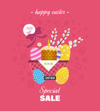 Festive, beautiful, Easter baskets with painted eggs, flowers, bakery products. Stock Image