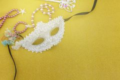 A festive,Beautiful white mardi gras or carnival mask on beautiful colorful paper background.  stock photo