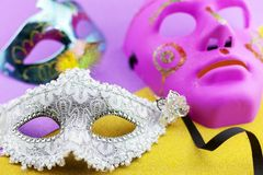 A festive,Beautiful white mardi gras or carnival mask on beautiful colorful paper background.  stock image
