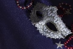 A festive,Beautiful white mardi gras or carnival mask on dark background royalty free stock images