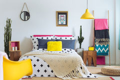 Festive bedroom of folk lover. Mix of styles and materials Royalty Free Stock Image