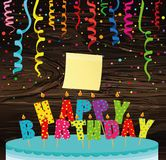 A festive big cake with candles. Letters Happy Birthday. Colorfu. L Confetti .  Empty Yellow sheet of paper for notes. Sticker. Greeting card or invitation for a Royalty Free Stock Photos