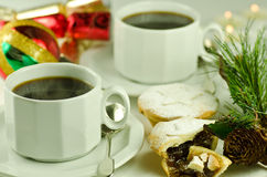 Festive black coffee and mince pies Stock Image