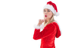 Festive blonde blowing a kiss Royalty Free Stock Photos