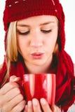 Festive blonde blowing over mug Stock Photos