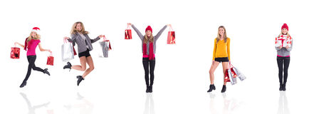 Festive blonde carrying gift bags Royalty Free Stock Photos
