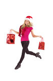 Festive blonde carrying gift bags Royalty Free Stock Photo