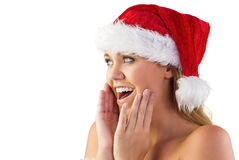 Festive blonde with hands on face Royalty Free Stock Photography