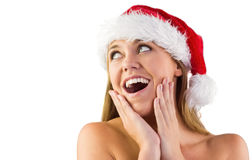 Festive blonde with hands on face Stock Photo