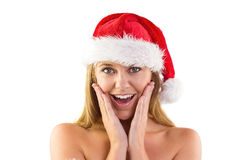 Festive blonde with hands on face Stock Photography