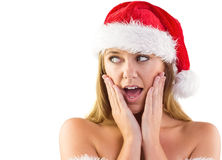 Festive blonde with hands on face Stock Images