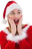 Festive blonde with hands on face Royalty Free Stock Image