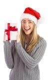 Festive blonde holding christmas gift Stock Photos