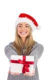 Festive blonde holding christmas gift Royalty Free Stock Image