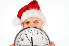 Festive blonde holding a clock Royalty Free Stock Images