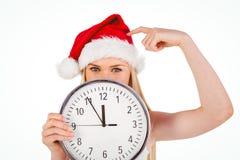 Festive blonde holding a clock Stock Photo