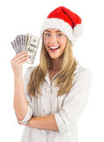 Festive blonde holding fan of dollars Stock Photos
