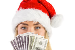 Festive blonde holding fan of dollars Stock Images