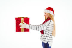Festive blonde holding a gift Stock Image