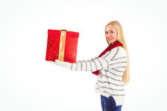 Festive blonde holding a gift Royalty Free Stock Photography