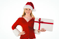 Festive blonde holding a gift Royalty Free Stock Images