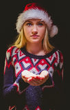 Festive blonde holding her hands out Royalty Free Stock Images