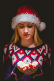 Festive blonde holding her hands out Royalty Free Stock Photography