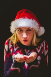 Festive blonde holding her hands out Royalty Free Stock Photo