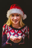 Festive blonde holding her hands out Stock Photo