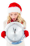 Festive blonde holding large clock Royalty Free Stock Photo