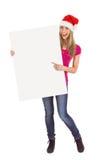 Festive blonde holding large poster Stock Photo