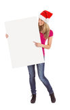 Festive blonde holding large poster Royalty Free Stock Image