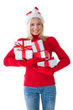 Festive blonde holding many presents Stock Photo