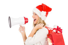Festive blonde holding megaphone and bags Stock Photography