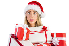 Festive blonde holding pile of gifts Royalty Free Stock Photography