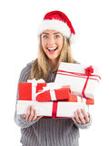 Festive blonde holding pile of gifts Stock Photography