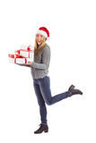 Festive blonde holding pile of gifts Royalty Free Stock Images