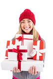 Festive blonde holding pile of gifts Stock Images