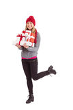 Festive blonde holding pile of gifts Royalty Free Stock Photo
