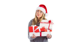 Festive blonde holding pile of gifts Stock Photo