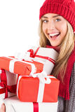 Festive blonde holding pile of gifts Stock Image