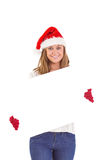 Festive blonde holding a poster Stock Image