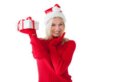 Festive blonde holding a present Royalty Free Stock Images